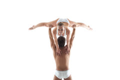 Smiling acrobat posing leaning on partner Royalty Free Stock Images