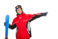 Smiling active man with ski pointing on empty space. Stock Images