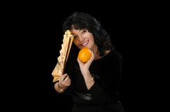 Smiling actress holds folding fan and orange Royalty Free Stock Photography