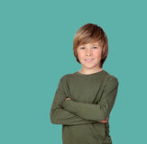 Smiling adolescent with a happy gesture. On a green background Stock Photo