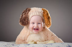 Costume party! Adorable baby boy with a puppy cost Royalty Free Stock Image