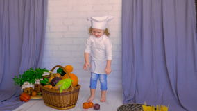 Smiling adorable child put vegetables into basket. Healthy eating concept stock video footage