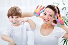 Smiling adorable family enjoy in colors Royalty Free Stock Photo