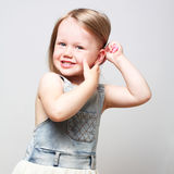 Smiling adorable girl combing her hair. royalty free stock photo