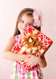 Smiling adorable little girl with christmas gift box Stock Photos
