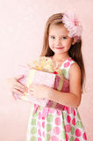 Smiling adorable little girl with christmas gift box Royalty Free Stock Photo