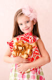 Smiling adorable little girl with christmas gift box Royalty Free Stock Image
