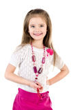 Smiling adorable little girl in skirt with beads isolated Stock Photo
