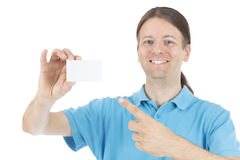 Smiling adult caucasian man pointing to a business sign card Stock Image