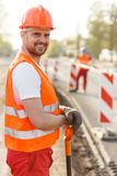 Smiling adult construction worker Stock Image
