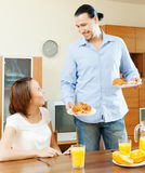 Smiling adult couple having breakfast Royalty Free Stock Photography