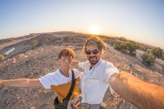 Smiling adult couple taking selfie in the Namib desert, Namib Naukluft National Park, travel destination in Namibia, Africa. Fishe Royalty Free Stock Photos
