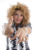 Smiling adult female pointing you Stock Photography
