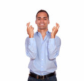 Smiling adult man crossing his fingers Stock Photos