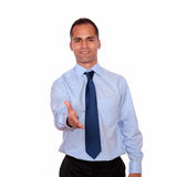 Smiling adult man extending handshake at you Royalty Free Stock Photo