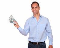Smiling adult man holding cash dollars Royalty Free Stock Image