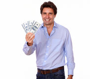 Smiling adult man holding cash dollars Royalty Free Stock Photo