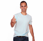 Smiling adult man looking and showing you ok sign Royalty Free Stock Images