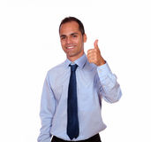 Smiling adult man looking and showing you ok sign Royalty Free Stock Image
