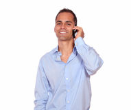 Smiling adult man speaking on cellphone Royalty Free Stock Photos
