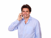 Smiling adult man speaking on cellphone Stock Photography