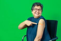 Free Smiling Adult Senior Asian Woman Smile With Confident Show Shoulder With Band Aid Plaster After Getting Coronavirus Of Covid-19 Royalty Free Stock Photography - 217665417