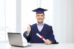 Smiling adult student in mortarboard with diploma. Education, graduation, business, technology and people concept - happy adult student in mortarboard with Stock Photography