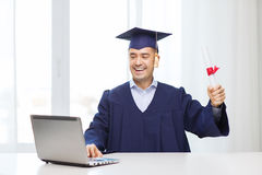 Smiling adult student in mortarboard with diploma. Education, graduation, business, technology and people concept - happy adult student in mortarboard with Royalty Free Stock Images