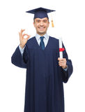 Smiling adult student in mortarboard with diploma Royalty Free Stock Photos