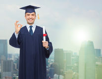 Smiling adult student in mortarboard with diploma Royalty Free Stock Images