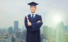 Smiling adult student in mortarboard with diploma stock image