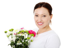 Smiling adult woman with bouquet Stock Photo
