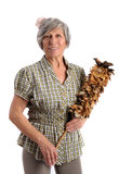 Smiling Adult Woman Holding Feather Duster. Smiling Gray Hair Adult Woman in Checkered Blouse Holding Feather Duster Looking at Camera. Captured at Studio on Stock Image