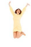 Smiling adult woman jumping with hands up Royalty Free Stock Photo