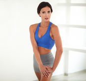 Smiling adult woman in yoga class exercising Royalty Free Stock Photo