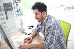 Smiling adult working at office Royalty Free Stock Image