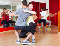 Smiling adults dancing bachata Stock Images