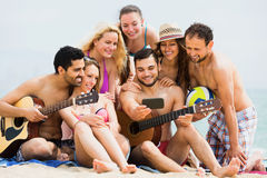 Smiling adults doing selfie at sea shore Royalty Free Stock Photos