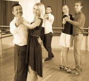 Smiling adults enjoying of classical dance. Smiling happy adults enjoying of classical dance in class stock photo