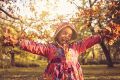 Smiling African America girl in nature. stock photos