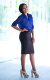 Smiling african american business woman standing outside Stock Image