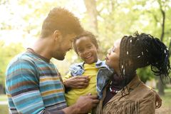 African American family enjoying in park together. stock photography