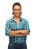 Smiling african american girl in eyeglasses. Hapiness and people concept - smiling young african american woman in eyeglasses with crossed arms Stock Image