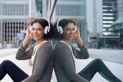 Smiling african american girl listening to music on headphones Royalty Free Stock Photo