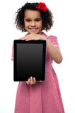 Smiling african american girl presenting tablet pc Stock Photos