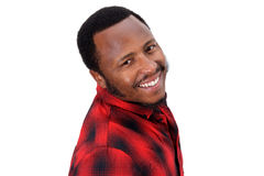Smiling african american guy against isolated white background Stock Images
