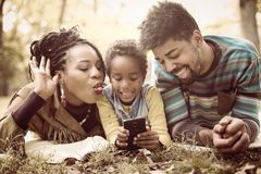African American little girl taking self picture in park stock image