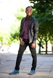 Smiling african american man in black leather jacket Royalty Free Stock Image