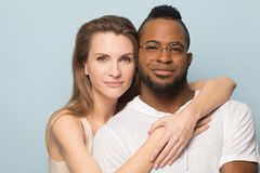 Happy multiracial couple look at camera posing together royalty free stock images