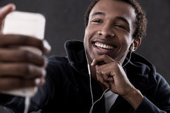 Smiling African American man taking self portrait Royalty Free Stock Images